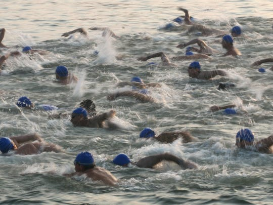 take to the water as part of a past Pineapple Man Triathlon.