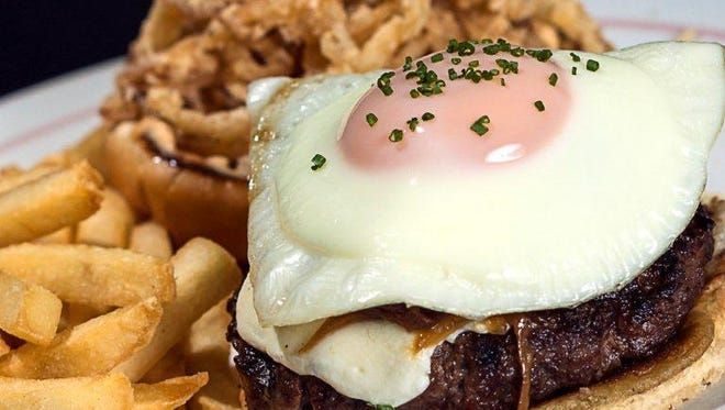 This breakfast burger is loaded with cholesterol. But new dietary guidelines may say that this doesn't matter as much as we thought.