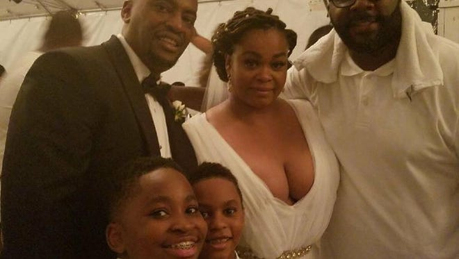 Jill Scott poses with her husband Mike Dobson, his friend DJ Mars and Dobson's sons.