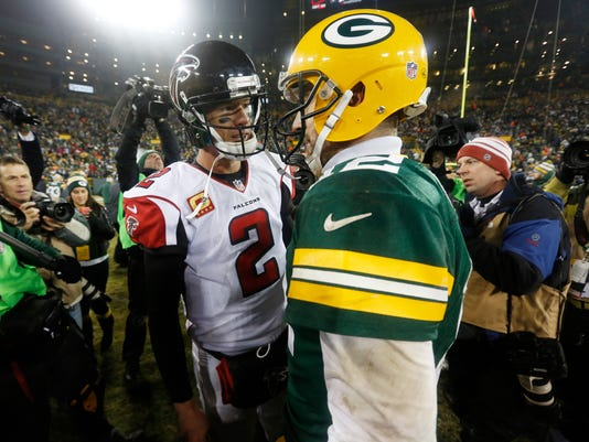 Atlanta Falcons quarterback Matt Ryan (2) talks to Green Bay Packers quarterback Aaron Rodgers after an NFL football game Monday, Dec. 8, 2014, in Green Bay, Wis. The Packers won 43-37. (AP Photo/Mike Roemer)