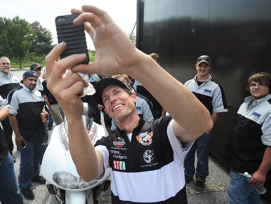 """Steve Johnson, NHRA Pro Stock Motorcycle rider and two-time NHRA U.S. Nationals Champion, takes a """"selfie"""" while visiting with the students from the YTI Motorcycle Center on Thursday, Oct. 3, 2013."""
