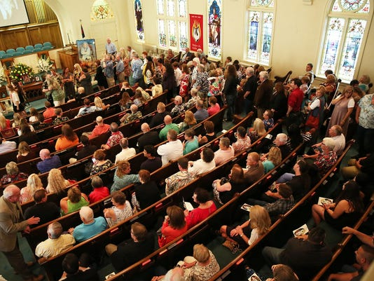 2 A standing room only crowd attended the memorial service of Chuck McGill Sunda