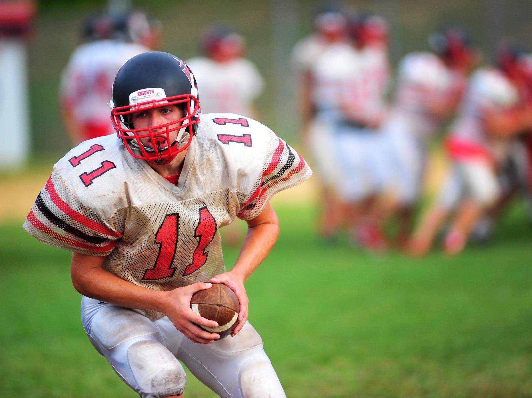 Junior quarterback Daymon Fleming runs a drill during practice.