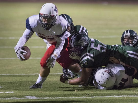 Tulare Western's Mason Bernardo eyes the goal line before scoring against El Diamante in a non-league football game on Friday, August 26, 2016.