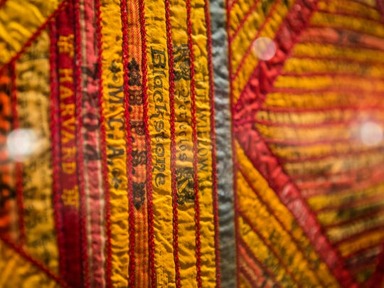 A cigar-silks quilt sits on display at the booth of Earle D. Vandekar of Knightsbridge Inc. from White Plains, N.Y., at the Delaware Antiques Show on Sunday afternoon.
