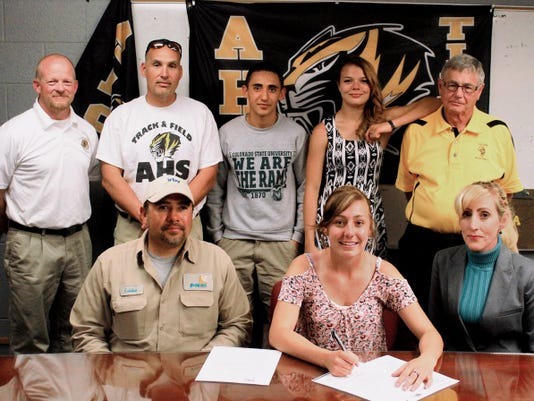 Peter Dindinger — Daily News Caylin Montoya, front center, signed her National Letter of Intent to run track and cross country at Georgian Court University on Tuesday afternoon in front of friends, family and coaches.
