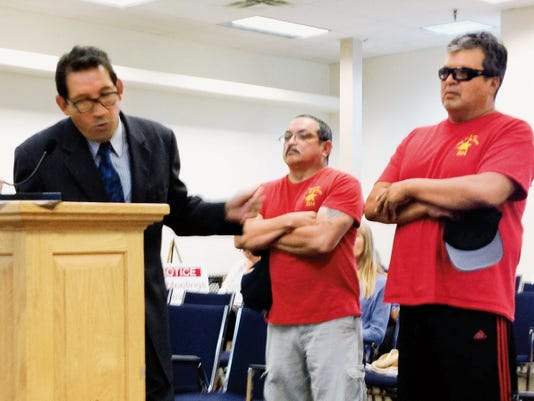 Raul Turrieta, left, discusses the upcoming Walk for the Heroes, a fundraising walk from Hurley to Santa Clara, during Tuesday's Silver City Town Council meeting. Randal Seyler - Sun-News