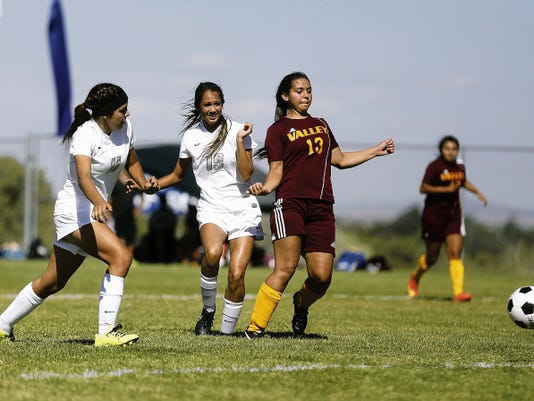 Piedra Vista's LisaMarie Jones, No. 19, scores a goal against Valley Friday with an assist from teammate Lexi Atencio during a match at Piedra Vista High School in Farmington.
