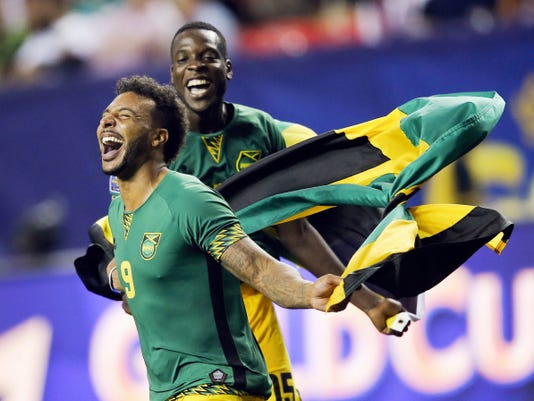 Jamaica's Giles Barnes (9) and Je-Vaughn Watson (15) celebrate after Jamaica defeated the United States ,2-1, in a CONCACAF Gold Cup soccer semifinal Wednesday in Atlanta. Jamaica is the first Caribbean nation to reach a Gold Cup final.