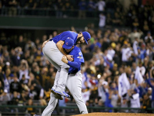 Chicago Cubs first baseman Anthony Rizzo, right, holds Chicago Cubs starting pitcher Jake Arrieta after they defeated the Pittsburgh Pirates in the National League wild card baseball game 4-0, Wednesday in Pittsburgh. The Cubs advance to play the St. Louis Cardinals in the National League Division Series.