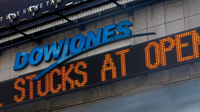 A Dow Jones news ticker in New York's Times Square carries headlines about the stock market.
