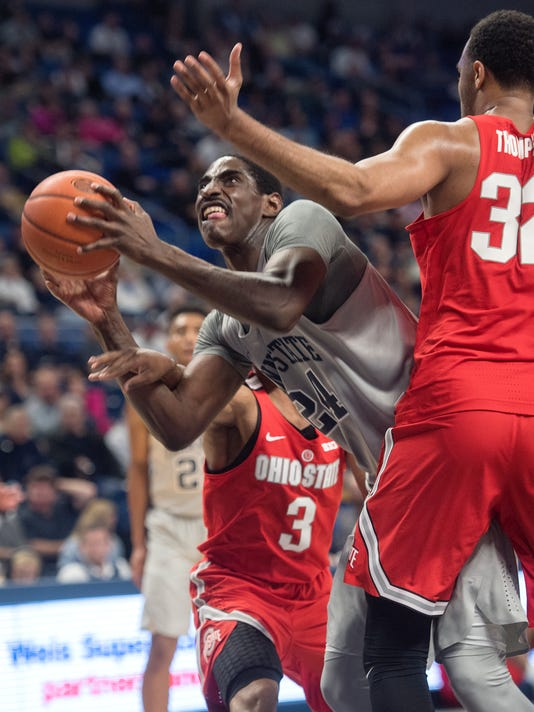 Penn State's Mike Watkins dives through Ohio State defenders during an NCAA college game Tuesday, Feb. 28, 2017, in State College, Pa. (Abby Drey/Centre Daily Times via AP)