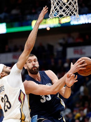 New Orleans Pelicans forward Anthony Davis (23) fouls Memphis Grizzlies center Marc Gasol (33) in the first half of an NBA basketball game in New Orleans, Saturday, Jan. 20, 2018. (AP Photo/Gerald Herbert)
