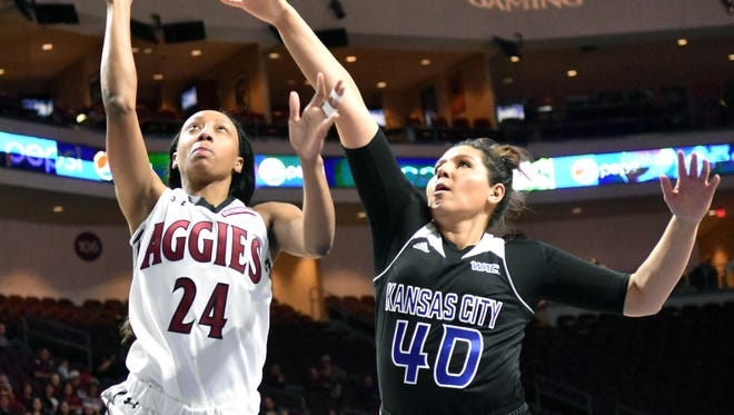 New Mexico State's Brianna Freeman goes up for a shot as the Aggies took on Missouri-Kansas City Friday afternoon in the WAC Women's Basketball Tournament in Las Vegas, Nevada.