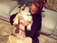 Chrissy Teigen was dwarfed by her hefty bulldog in this photo.