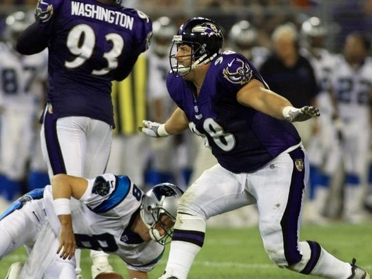Baltimore Ravens' Tony Siragusa does a celebratory dance over Carolina Panthers quarterback Jeff Lewis after sacking him for an 11-yard loss in the second quarter of an NFL preseason game in Baltimore on Saturday, Aug. 28, 1999. (AP Photo/Roberto Borea)