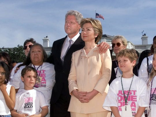 President Bill Clinton and First Lady Hillary Rodham Clinton look on from the South Lawn of the White House during the Million Mom March in 2000.