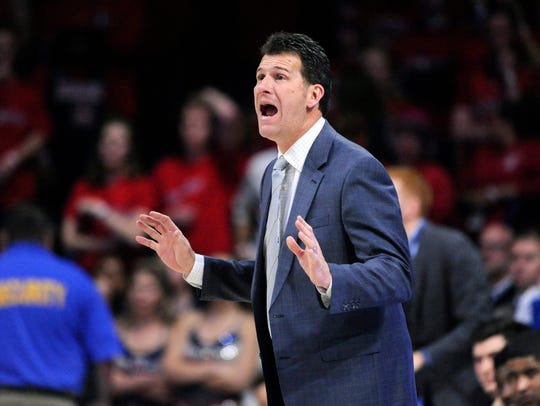 Bruins coach Steve Alford calls to his players during