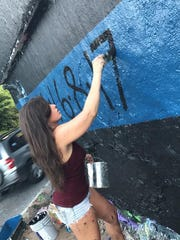 Deanna Stevison's friend, Jamie Winters, paints Pensacola's