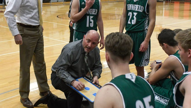 Pennfield head coach Nate Burns talks to his players between quarters Friday night.