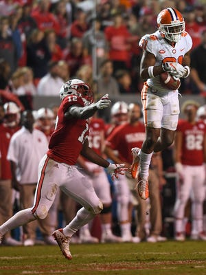 Clemson defensive back Ryan Carter (31) intercepts a pass intended for NC State wide receiver Stephen Louis (12) during the 4th quarter on Saturday, Nov. 28, 2017 at Clemson's Memorial Stadium.