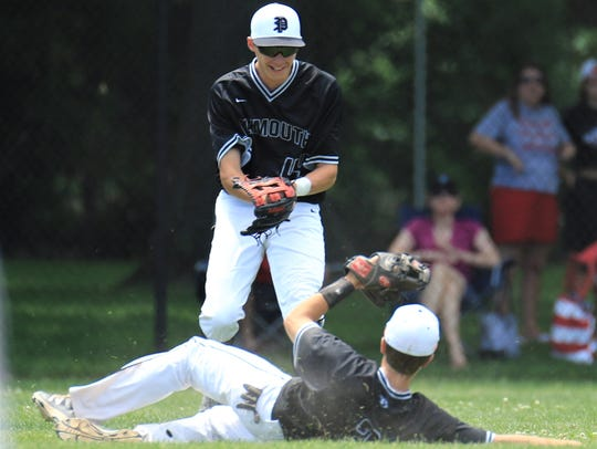 Sliding to make a nice catch for Plymouth during the