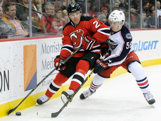 New Jersey Devils' Marek Zidlicky, left, of the Czech