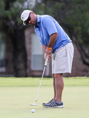 Jason Ball putts during the Bentwood Country Club Men's Partnership Thursday, July 13, 2017. Ball and Jack Graves shot a 5-under par 67 to take a three-shot advantage after the opening round.