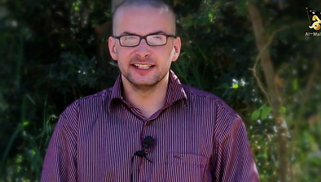 A video released by al-Malahem Media on Thursday purportedly shows U.S. hostage Luke Somers, 33, kidnapped more than a year ago in the Yemeni capital Sanaa, calling for help and saying that his life is in danger.