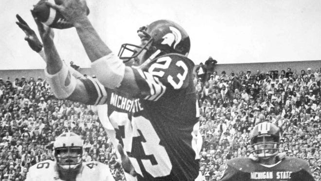 Michigan State wide receiver Kirk Gibson catches a pass in a game during his record-setting college career in 1975-1978.
