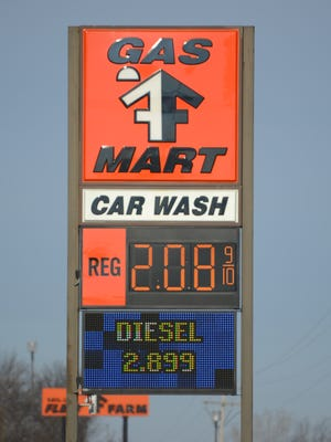 The Fleet Farm Gas Mart sign on Main Street in Bellevue shows the difference between regular unleaded and diesel fuel prices.