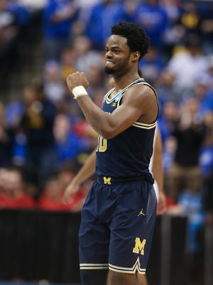 Michigan Wolverines guard Derrick Walton Jr. reacts to a call during the second half of U-M's 73-69 win over Louisville on Sunday, March 19 at Bankers Life Fieldhouse in Indianapolis in the second round of the 2017 NCAA tournament.
