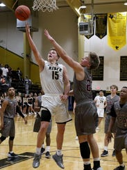 Rider's Carson Sager puts in a layup against Sherman
