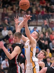 Colonel Crawford's Harley Shaum goes for a rebound.