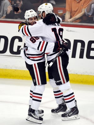 Chicago Blackhawks center Jonathan Toews (19) celebrates with right wing Patrick Kane (88) after scoring a goal against the Anaheim Ducks in the first period in game seven of the Western Conference Final of the 2015 Stanley Cup Playoffs at Honda Center.