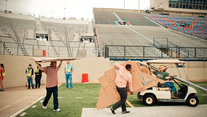 SleepOut 4 Independence takes shape at Independence Stadium as participants carry materials onto the field.