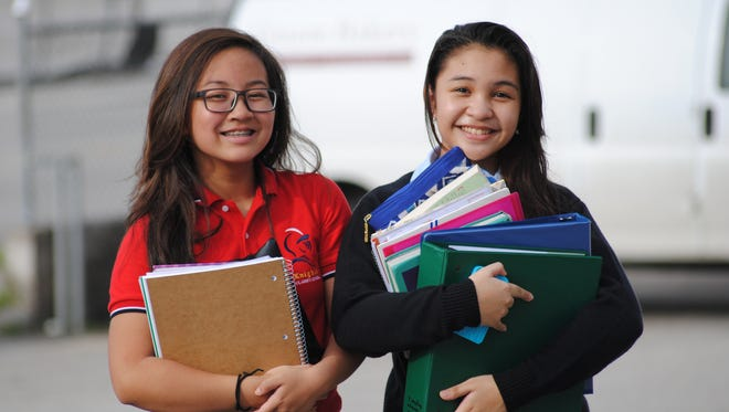 First cousins Chloe Oftana, left and Mariana Tamayo, both 14, are making a successful transition to high school. Oftana attends St. John's School and Tamayo, the Academy of Our Lady of Guam.