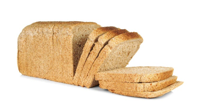 Stock image of whole wheat sliced bread.