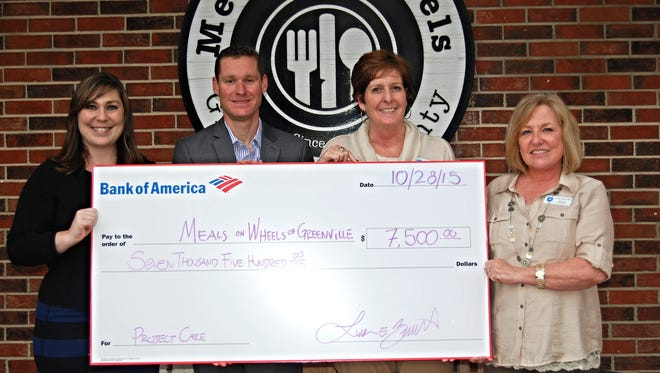 Bank of America's Brittany Hilbert and Luke Barnett with Meals on Wheels Executive Director Catriona Carlisle and Director of Development Lorain Crowl