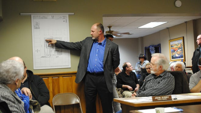 Jim Hornecker with Oppidan Investment Company, presented an upgraded proposal to build a Shopko Hometown store on the old elementary school site at the Monday, Dec. 14, Williamsburg City Council meeting. About 60 area residents attended the meeting to voice their opposition.