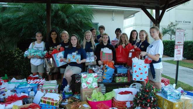 Students at Holy Trinity have hosted gift drives this year to support immigrant students in Fellsmere and seniors citizens.