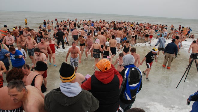 An estimated 900 swimmers took part in the 24th annual Jacksonport Polar Bear Club Swim – Jan. 1, 2010, at Lakeside Park.