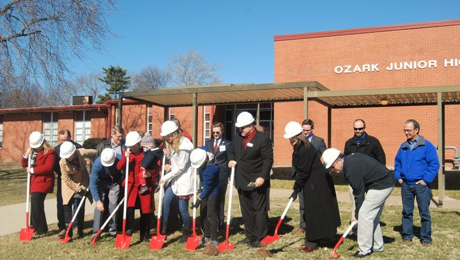 Administrators, architects, students, staff and community members break ground on the new storm shelter project at noon, Thursday, Feb. 4, at Ozark Junior High School, 1109 W. Jackson St.