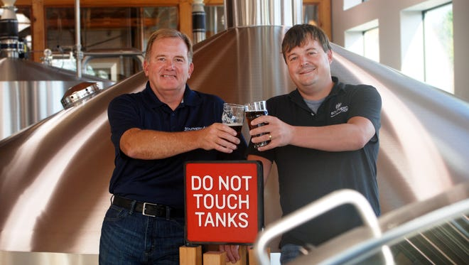 John Coleman (left), CEO of Artisanal Brewing Ventures, and Phin DeMink, founder of Southern Tier Brewing, two key figures at the center of this new craft brewing partnership.