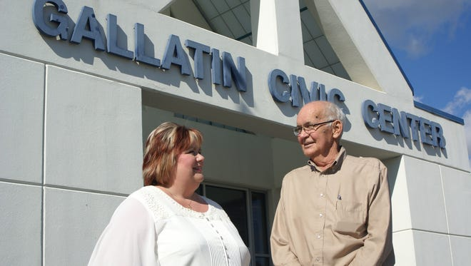 Former Gallatin Mayor and council member Tommy Garrott talks with At-Large Councilor Julie Brackenbury outside the Gallatin Civic Center in 2013.