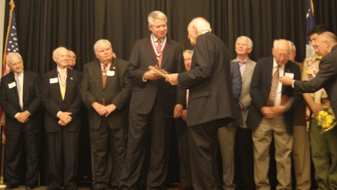 Michelin North America chairman and president Pete Selleck receiving the Distinguished Eagle Scout  award from the Blue Ridge Council, Boy Scouts of America, during their annual Patron Dinner fundraiser.