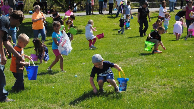 Kids set off to search for eggs at last year's Easter egg hunt, hosted by Signature HealthCARE.
