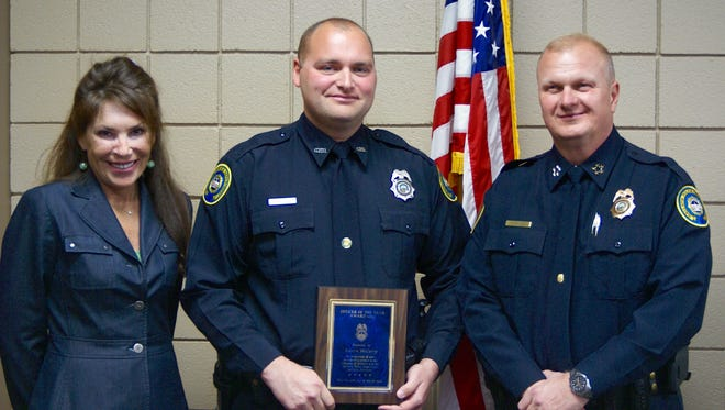 Gallatin Police Department Officer Austin McCurry, center, stands with Mayor Paige Brown and Chief Don Bandy after he was named the 2015 officer of the year during the department's annual awards ceremony Thursday, March 17.