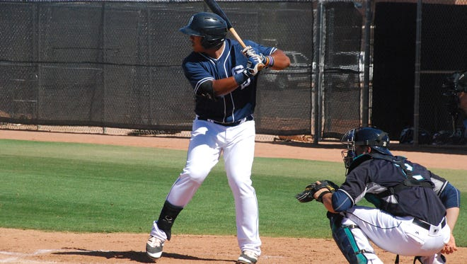 San Diego Padres prospect Trae Santos takes a pitch in a minor league spring training game against the Seattle Mariners on March 20.