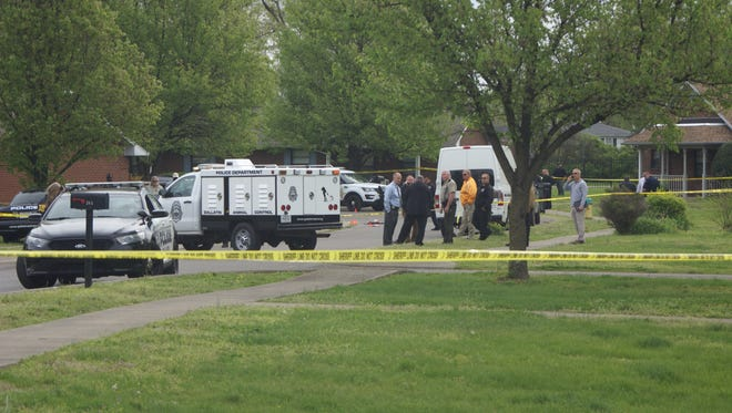 Officers respond to the scene of a fatal shooting Wednesday morning in Gallatin.